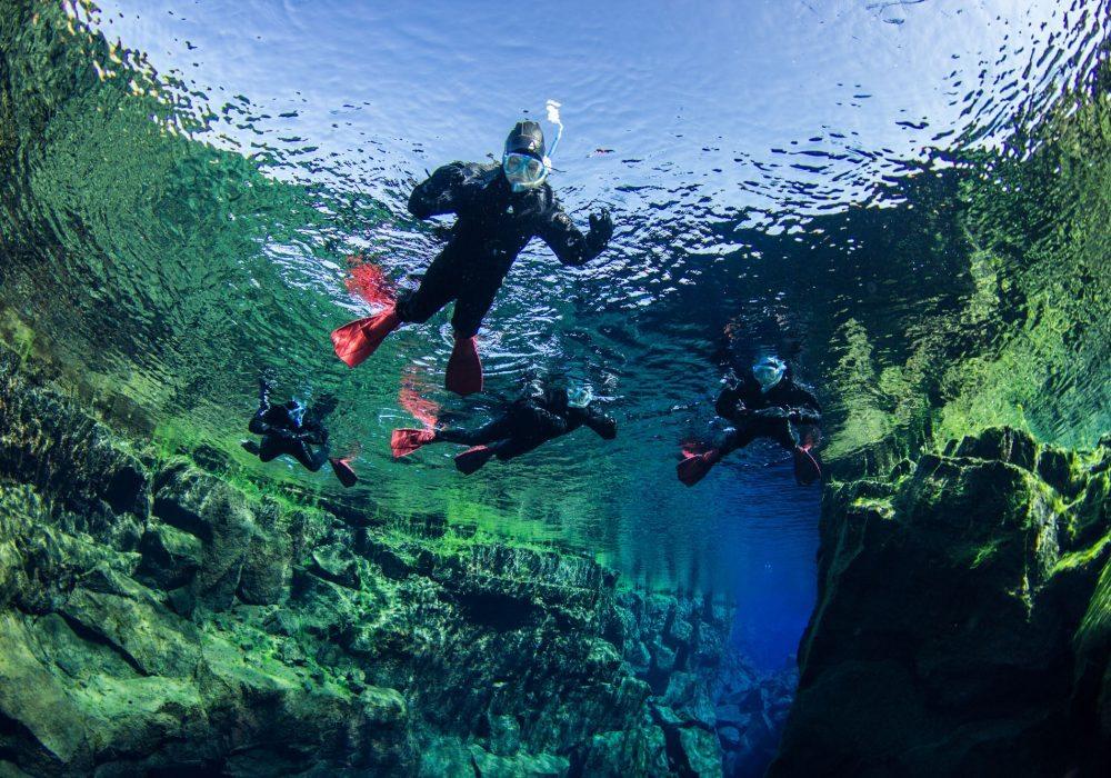 snorkeling in Silfra, Snorkelers in Iceland, Snorkel Silfra, snorkeling tour in Iceland, snorkeling in Silfra