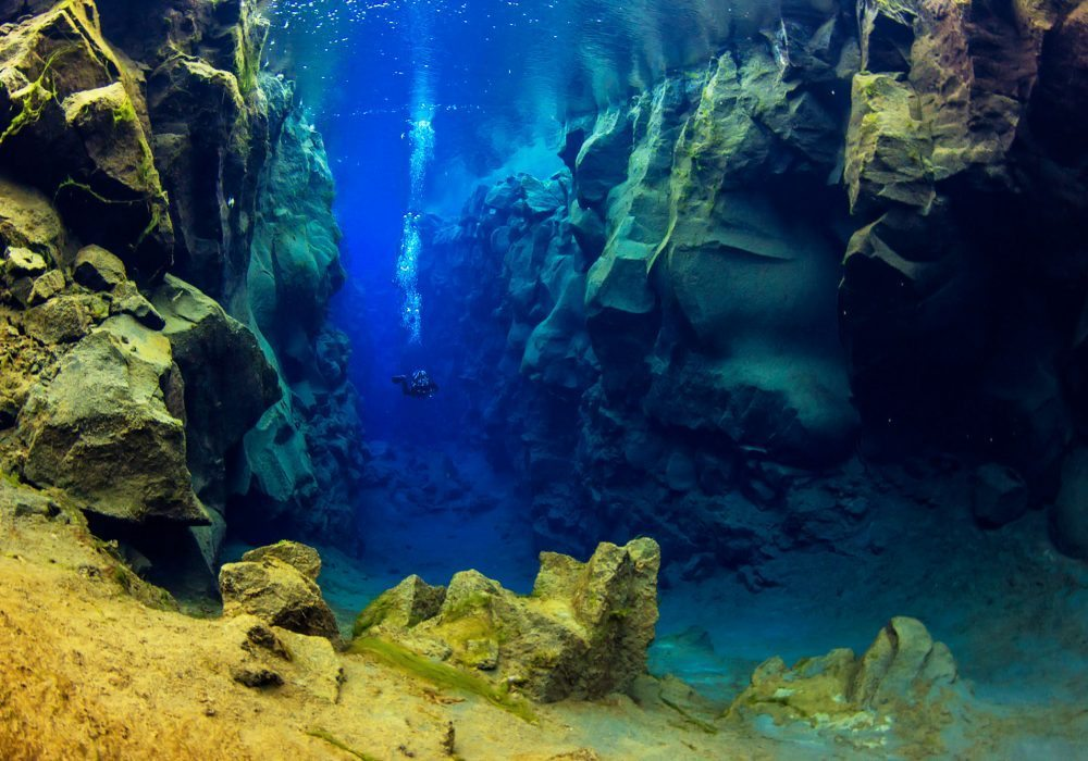 Diver in the Silfra Cathedral, during a scuba diving tour in Iceland