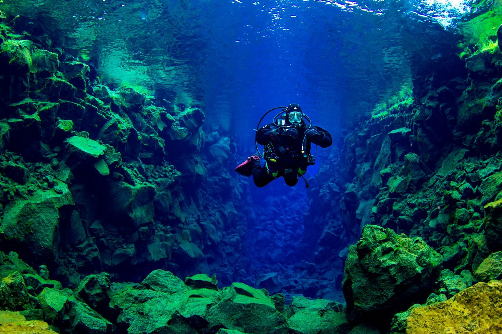 Scuba diver on Silfra fissure diving tour in Iceland