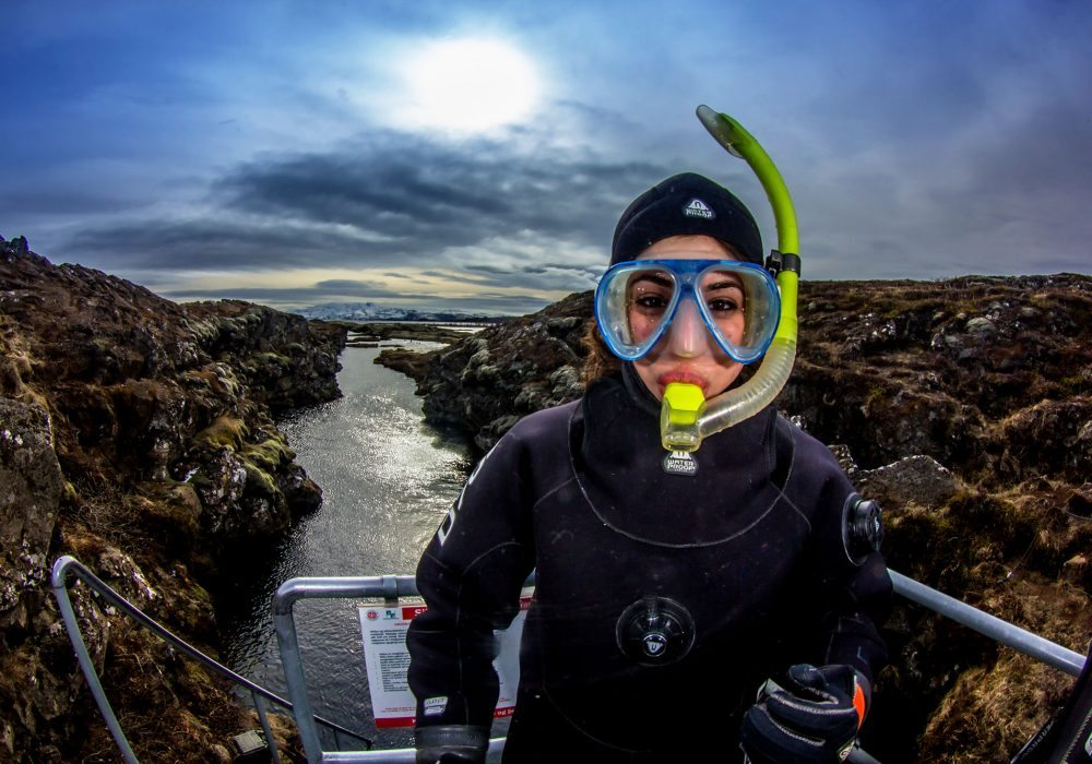 Snorkeler ready for snorkeling tour in Silfra Fissure in Thingvellir Nationalpark in Iceland