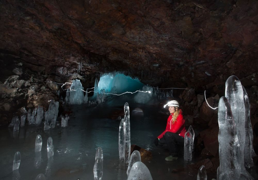 Ice in lava tube caving tour in Iceland