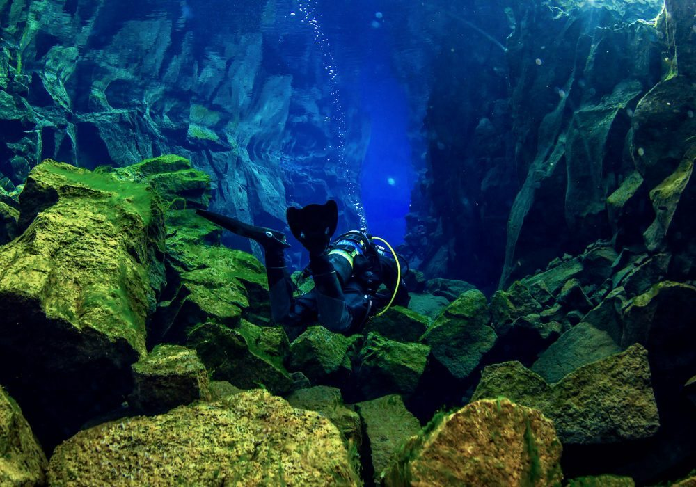 Scuba diver in the Silfra Cathedral during a dive tour in Iceland
