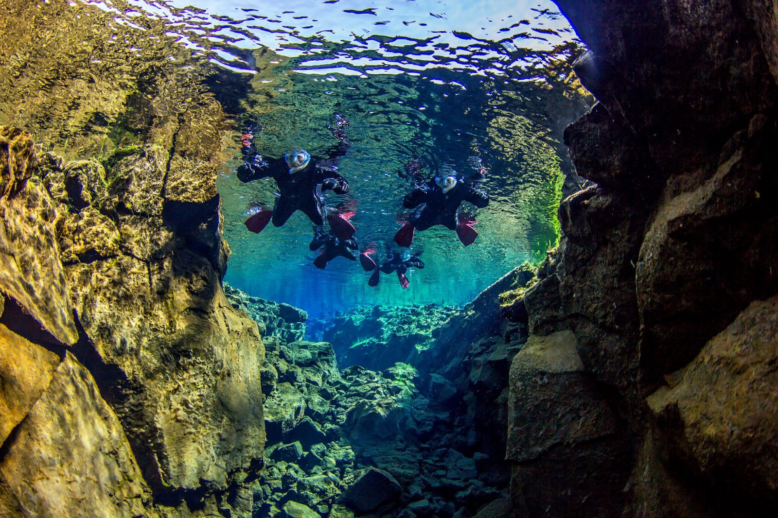 snorkelers in Silfra Iceland, snorkeling tour in Iceland, snorkelling in Silfra, snorkel Silfra