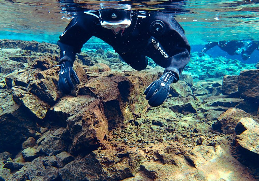 Person snorkelling in shallow part of Silfra Fissure