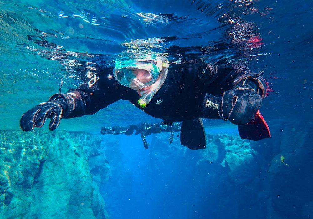 Man snorkeling in Silfra fissure