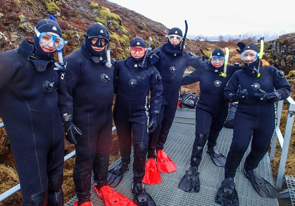 Group of people in drysuits ready for snorkeling